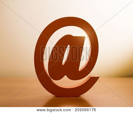 Wooded email symbol on table