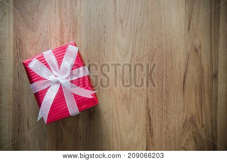 Christmas Holidays And Happy New Year Background. Gift Boxes With Red Paper And Silver Ribbon On Woo