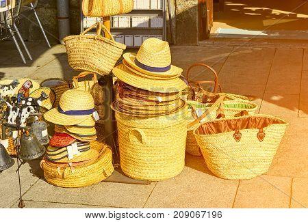 Straw bags in boutique in Porto, Portugal