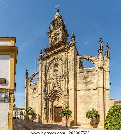 JEREZ DE LA FRONTERA,SPAIN - SEPTEMBER 30,2017 - View at facade of Santiago church in the streets of Jerez de la Frontera. Jerez is known as the city of flamenco sherry horses and motorcycles.