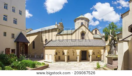 Panorama of southern facade of the church with arcade gallery and southern courtyard of the Armenian Cathedral of the Assumption of Mary built in the 14-th century in Lviv Ukraine