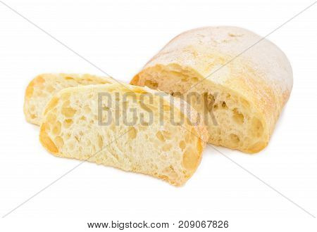 Partly cut loaf and two slices of the ciabatta on a white background closeup