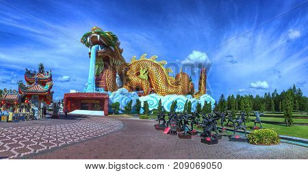 Dragon descendants museum, Suphan Buri, Thailand. Sculpture of Giant Dragon in Chinese style and Kung fu players
