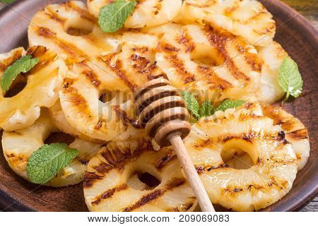 Grilled healthy pineapple with mint and honey