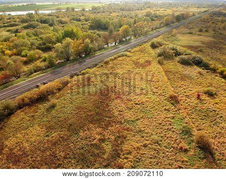 straight railway through the autumn landscape drone photo