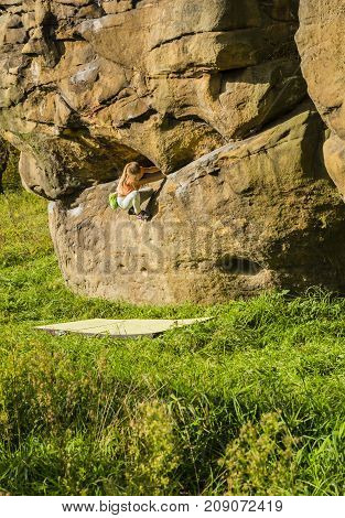 Climb Maja Oleksy During Bouldering Training In The Rocks.