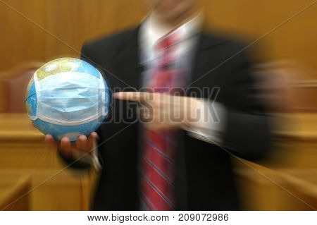 Politician holding the planet Earth global pollution concept