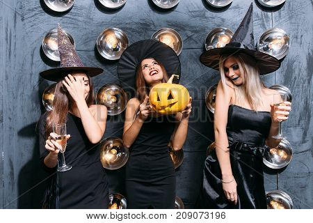 In Good Moods At Halloween Party. Womans With Pumpkins