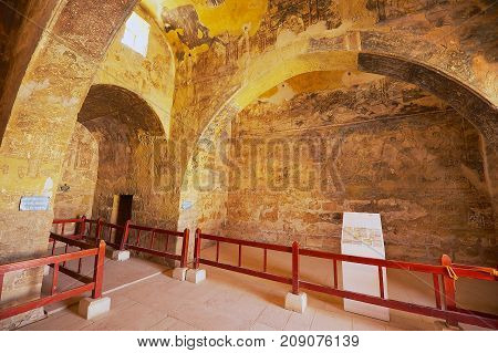 ZARQA, JORDAN - AUGUST 23, 2012: Interior of the ancient Umayyad desert castle of Qasr Amra with roman mural wall and ceiling decoration in Zarqa, Jordan.