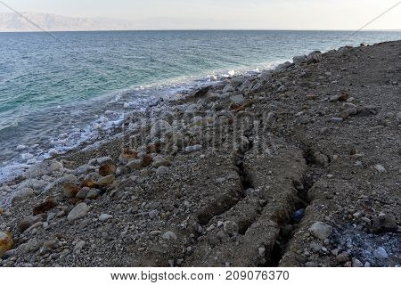Landslip cracks at Dead Sea contaminated coast in Israel.