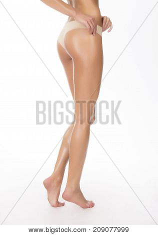 Healthy skin of caucasian woman in beige thongs. Studio isolated shot.