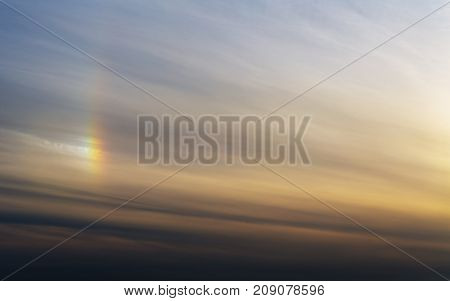 abstract sky with halo and clouds at sunset