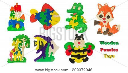 A set of children's wooden toys. Collage wooden puzzles toys. Castle, giraffes, fish, crocodile, fox, bear butterfly