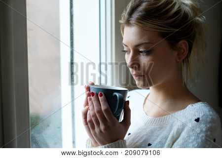 Sad Girl Portrait Holding A Cup Of Hot Drink