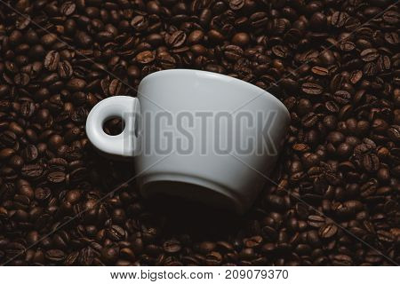 Mockup of coffee beans with white cup.