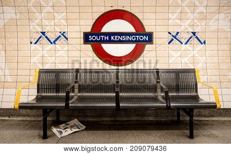 LONDON UK - 5 OCTOBER 2017: The traditional London Underground roundel shaped sign which incorporates the name of the current station. South Kensington in West London is famous for its museums and gardens.