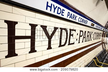LONDON UK - 5 OCTOBER 2017: The original tiled walls and London Underground signage at Hyde Park Corner. The blue colour coded Piccadilly Line station is in the affluent Mayfair district of West London between Hyde and Green parks.