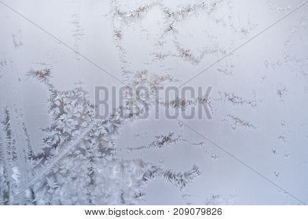 Intricate Winding Frosty Pattern On Window Glass In Winter.