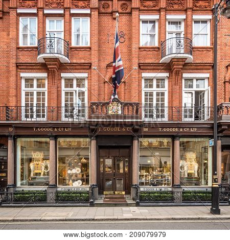 LONDON UK - 5 OCTOBER 2017: The shop front and victorian architecture of the china silverware and glass shop T. Goode & Co. Ltd. in the affluent Mayfair district of London. The shop's royal seal of approval is visible above the doorway.