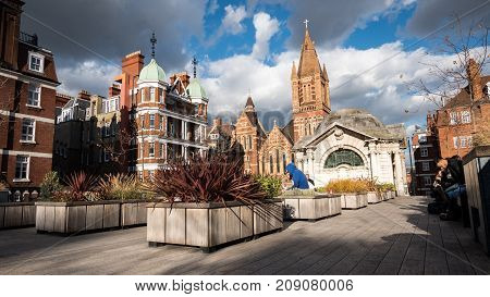 LONDON UK - 5 OCTOBER 2017: A view of Brown Hart rooftop gardens in the affluent inner city residential area of Mayfair West London on a bright autumnal day.