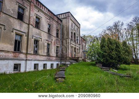Ruined mansion in small village Drezewo near Baltic Sea coast in Poland