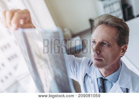 Senior Doctor In Clinic