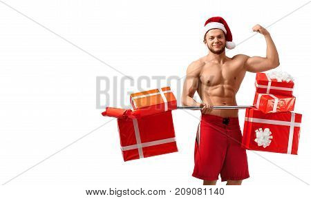 Let us train together. Studio shot of a toned shirtless Santa Claus after a workout with barbell full of gift boxes copyspace on the side