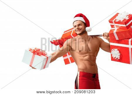 Christmas sales are on. Cropped halflenght studio portrait of a muscular naked Santa fitness man walking around with a barbell full of presents