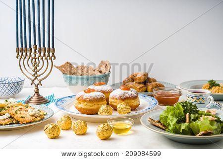 Jewish holiday Hanukkah, traditional feast side view horizontal