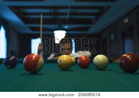 Young caucasian man playing billiards ready to shoot. Study to play billiard