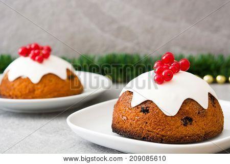 Christmas pudding on gray stone. Typical christmas sweet