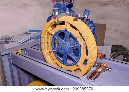 Pulley wheel . Reconstruction of industry lift. Closeup