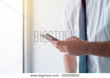 Businessman texting in free time. Business person on a break using smartphone to send sms text message.