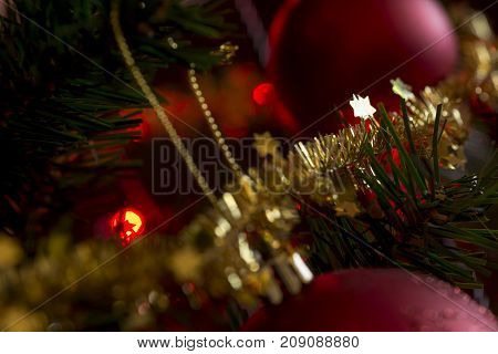Decorated Christmas Tree And A Close Up View Of Sparkling Gold Tinsel