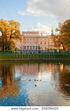 SAINT PETERSBURGRUSSIA - OCTOBER 3 2016. Michael or Engineers Castle in Saint Petersburg Russia and Karpiev pond in Summer garden. Saint Petersburg Russia architecture landscape