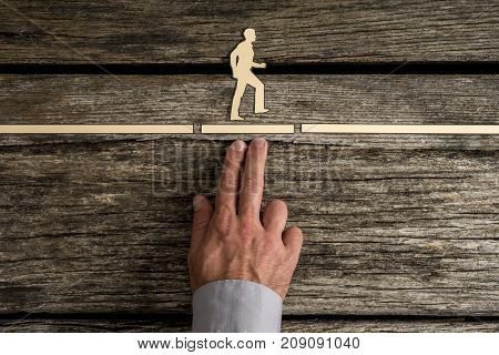 Business Teamwork Concept With The Hand Of A Businessman Supporting Paper Cut Out Of A Man