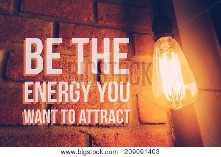 Inspirational and motivation quote on blurred light bulb background with vintage filter