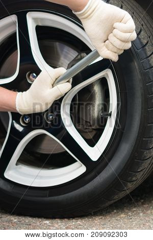replacement of rubber on the wheel of a car close-up of preparing a car for land