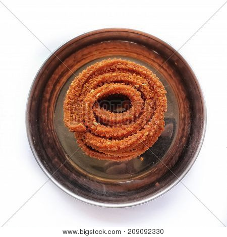 Diwali festival snacks from india.chakali or murukku is given to guest in this hindu festival as refreshment