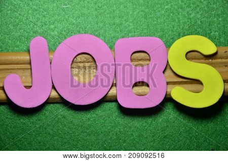 the word jobs on a  abstract green background