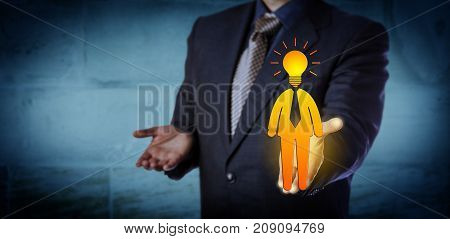 Unrecognizable recruitment agent offering a bright candidate icon with a light bulb for a head. Business concept for entrepreneurship talent management leadership initiative and inspiration.
