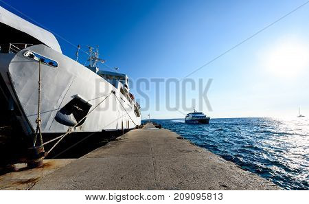 Front Loading Ferry Boat Moored With Lifted Bow At Pier.