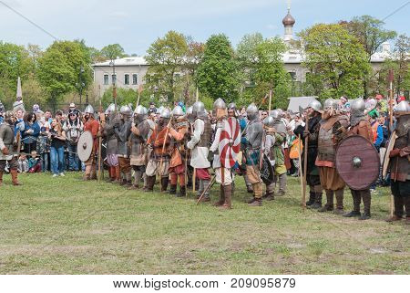 St. Petersburg Russia - May 27 2017: Demonstrative historical battle on the ancient weapons. Historical reconstruction of sword fighting in St. Petersburg Russia