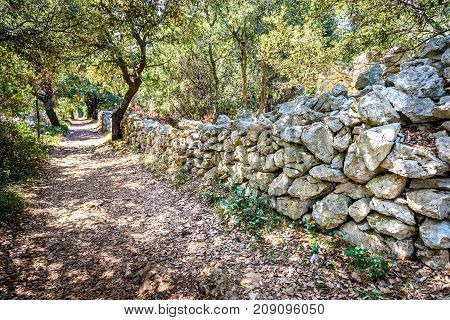 Stone Rock Fence Or Gabion And Road Or Footpath.