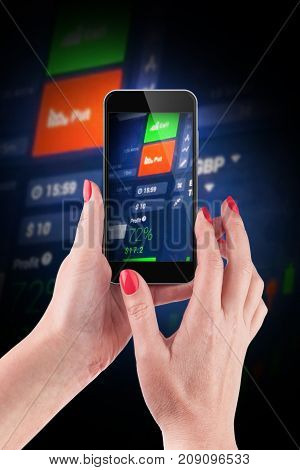 Female hand holding and touch a smartphone photographing a Stock market data in blue on LED display