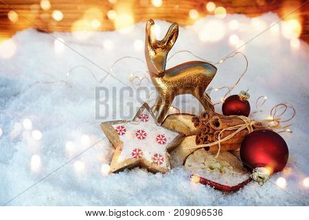 Still life in snow with christmas fragrance for a greeting card