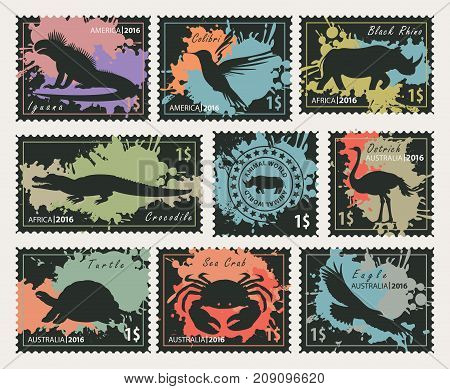 Vector set of postage stamps on the theme of wildlife animals and birds. Black silhouettes of animals on the colored blobs background.