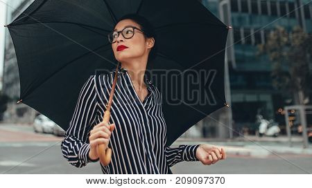 Business Woman On City Street With Umbrella