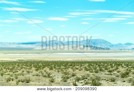 Nevada desert with bushes and mountains. Western landscape.