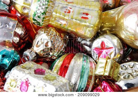 bright christmas balls and toys as background
